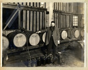 Rabbi with wine casks
